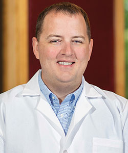 Dr. Gabriel Anders in a white coat
