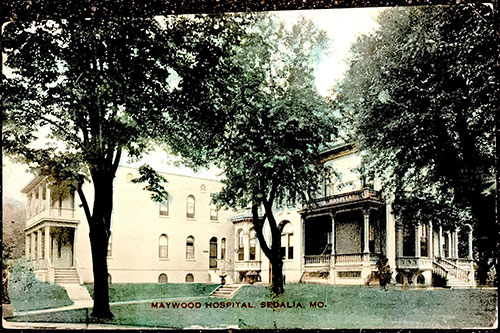 The front of a postcard of Maywood Hospital from 1908