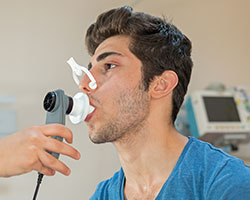 Man receiving respiratory care in Bothwell hospital respiratory care unit