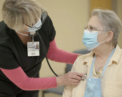 Provider treating patient in the cardiac and pulmonary rehabilitation unit