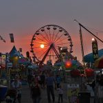 Attendees at the Missouri State Fair at dusk