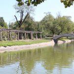 Sedalia Liberty Park pond and bridge on a sunny day